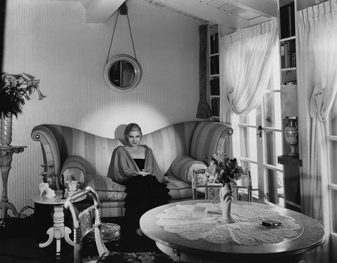<p>Shapely sofas are all the rage in Hollywood homes, like this one belonging to Vaudeville actress Lilyan Tashman.</p>