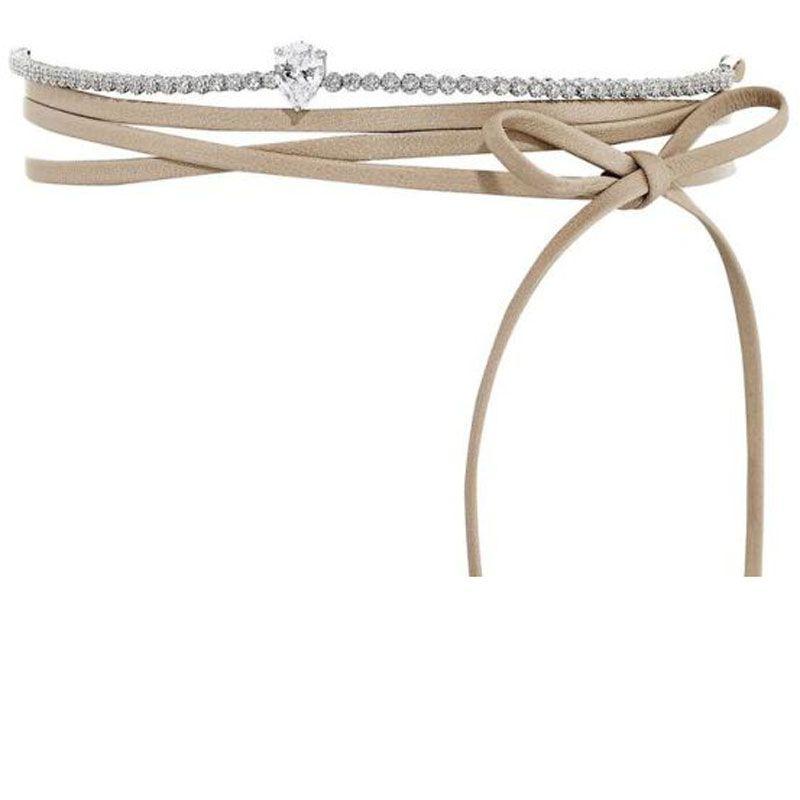 """<p><em>Monarch Micro Mini wrap choker in sand&#x3B; $240, <a href=""""http://fallonjewelry.com/product/monarch-micro-mini-pointed-wrap-choker-sand/"""" target=""""_blank"""">fallonjewelry.com</a></em></p>"""