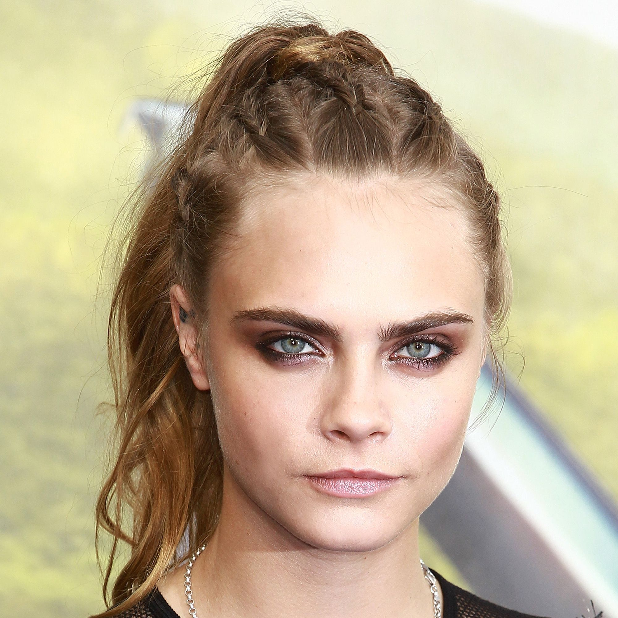 Up doesn't have to equal stodgy. Incorporate tightly woven braids or a metallic accessory to give a tail or twist an updated edge.<p><br></p><p><em>Cara Delevingne </em></p>