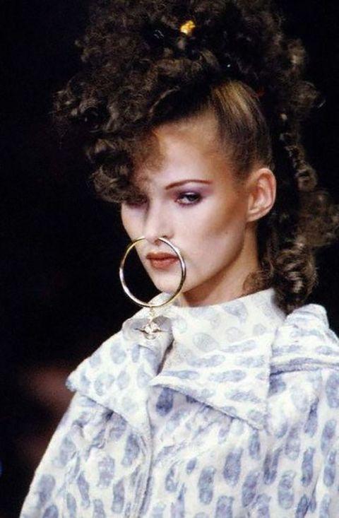 <p>Kate Moss walks Vivienne Westwood's Fall 1993 runway in an oversized septum hoop ring. </p>