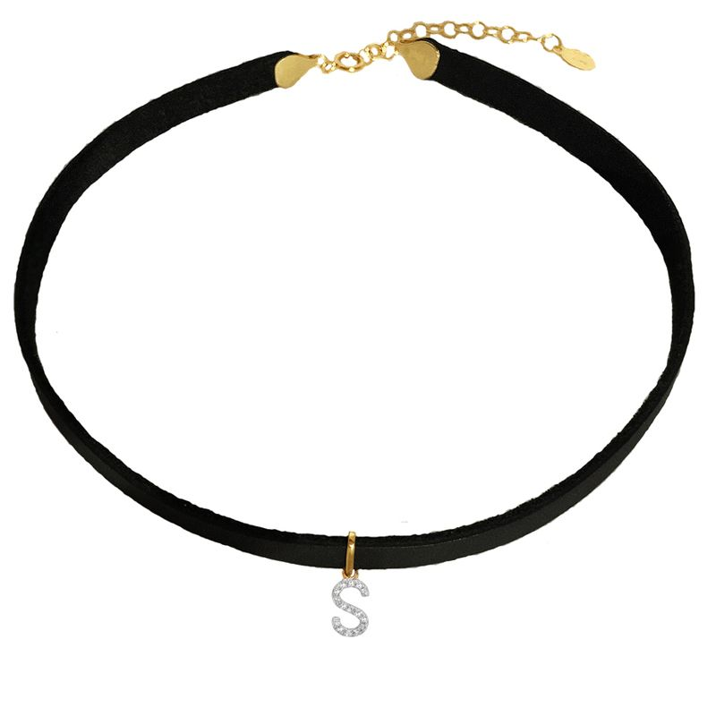 "<p><strong>Letters by Zoe</strong> choker, $345, <a href=""http://www.lettersbyzoe.com/diamond-initial-leather-choker/"" target=""_blank"">lettersbyzoe.com</a>. </p>"