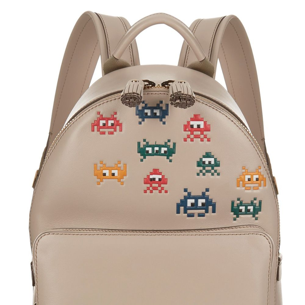 """<p><strong>Anya Hindmarch</strong> backpack, $1,450, <a href=""""http://us.anyahindmarch.com/en-US/space-invaders-mini-backpack-5050925922425.html#start=5&cgid=backpacks"""" target=""""_blank"""">anyahindmarch.com</a>. </p>"""
