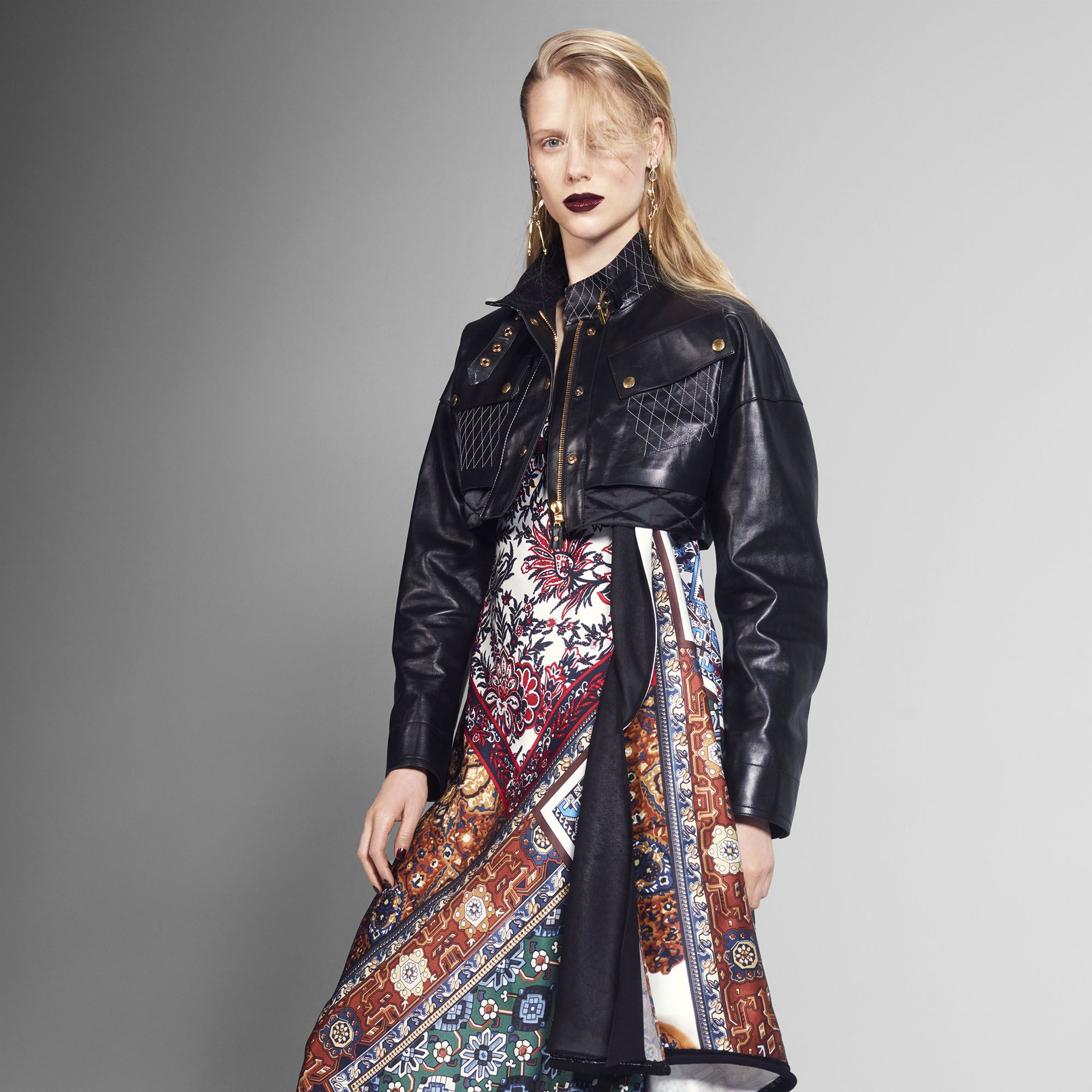 """<p>Contrast a feminine dress with a cropped moto.</p><p><strong>Louis Vuitton</strong> jacket, dress, earrings, and boots, prices upon request, 866-VUITTON.</p><p><strong>BEAUTY BAZAAR: </strong><a href=""""http://us.amorepacific.com/time-response-eye-renewal-creme"""" target=""""_blank"""">AmorePacific Time Response Eye Renewal Creme</a> brightens up eyes ($260).</p>"""