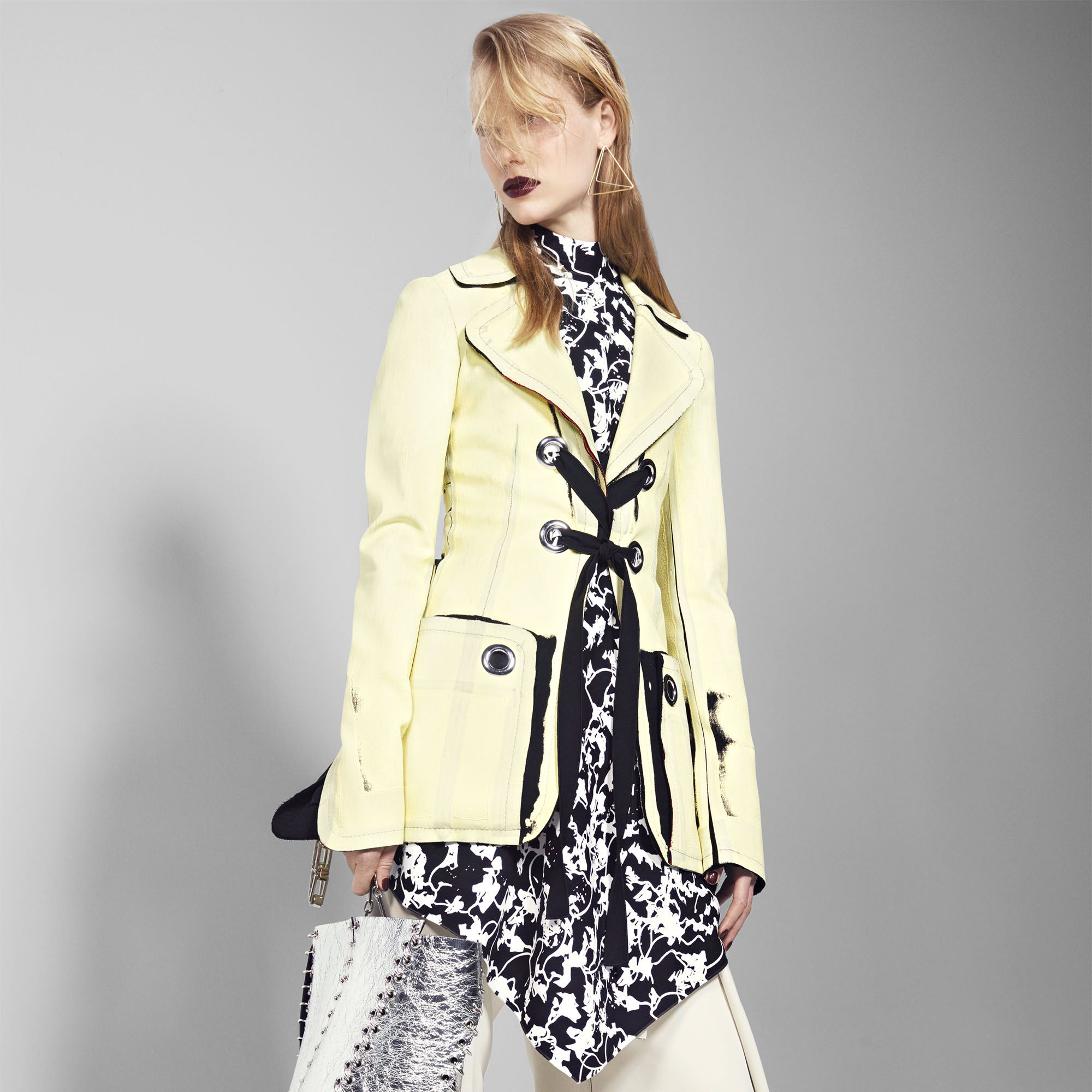 """<p><strong>Proenza Schouler</strong> jacket, $4,500, top, $1,185, pants, $1,250, bag, $1,960, and shoes, $980 212-420-7300&#x3B; <strong>Anndra Neen </strong>earrings, $75-$85, <a href=""""http://shop.tenover6.com/"""" target=""""_blank"""">tenover6.com</a>.</p>"""