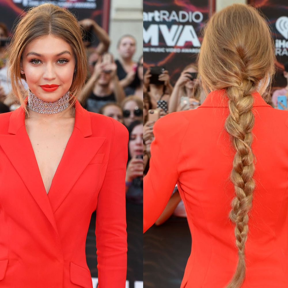 <p>When you're wearing diamonds, an all-eyes-on-you orange tux and matching lipstick, all you need is an easy, DIY hairstyle like Hadid's simple braid down the back. </p>