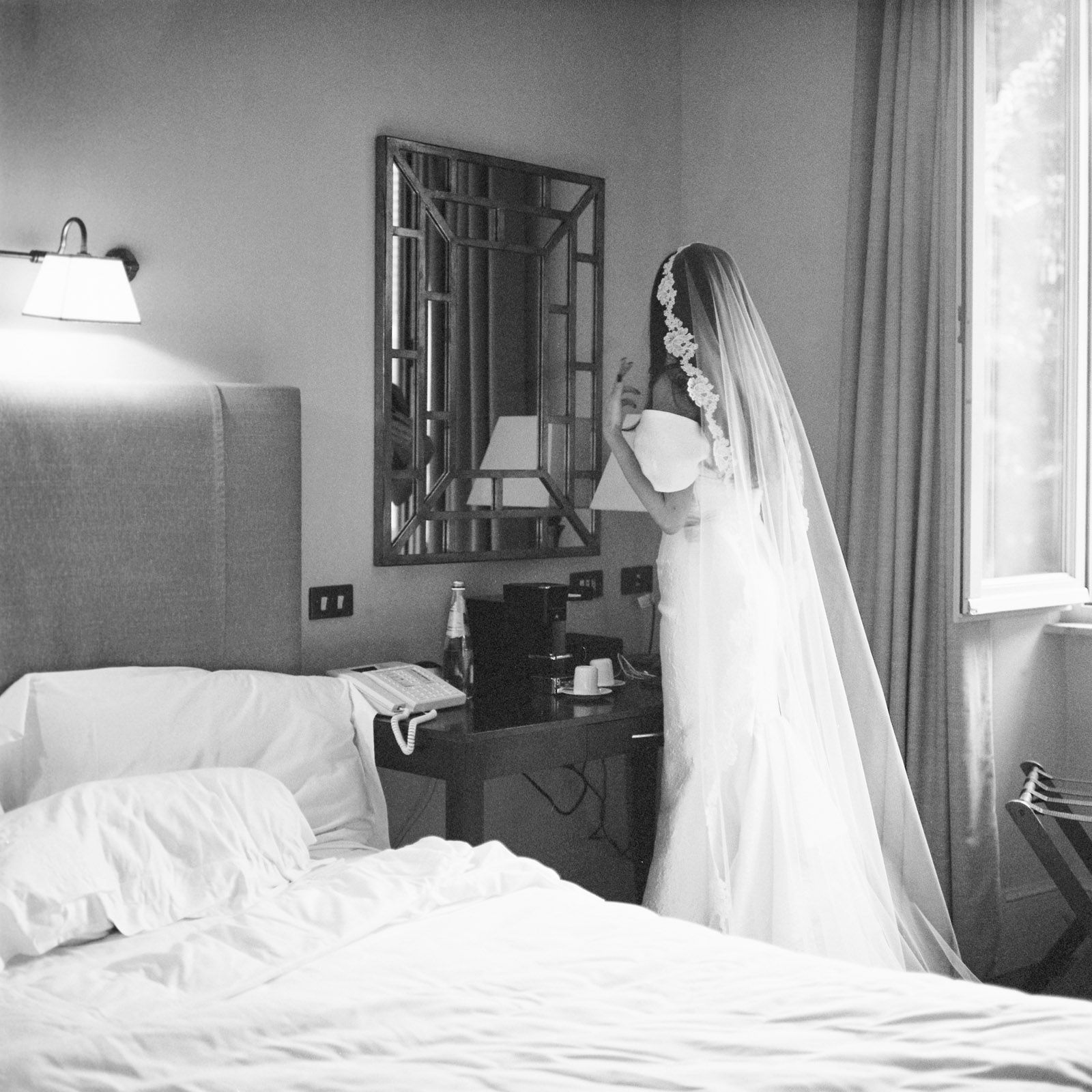 "<p>The bride, friends and family stayed at the <a href=""https://www.roccofortehotels.com/hotels-and-resorts/hotel-de-russie/?utm_source=google&utm_medium=local&utm_campaign=hotel_de_russie"" target=""_blank"">Hotel de Russie</a> the week preceding the wedding, and got dressed there before all of the weekend's events. Here, Natasha puts the finishing touches on her <a href=""http://moniquelhuillier.com"" target=""_blank"">Monique Lhuillier</a> gown and veil. ""The morning of the wedding did not go as I had planned, but nothing in life ever does—and I firmly believe that spontaneity is what makes it worth living,"" Natasha recalled. <span></span></p>"