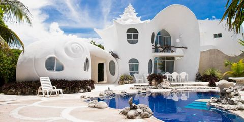 Architecture, Swimming pool, House, Water feature, Arch, Paint, Design, Outdoor furniture, Villa, Hacienda,