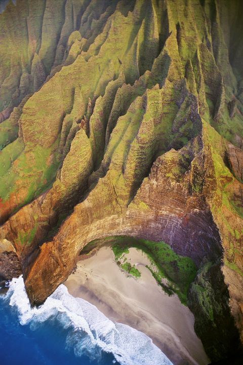 """<p><strong>Where: </strong>Honopu Beach, Hawaii<span class=""""redactor-invisible-space""""></span> </p><p><strong>Why We Love It: </strong>While there are too many beautiful beaches in Hawaii to pick just one, the remoteness of this stretch of sand on Kauai's Na Pali Coast make it one of our favorites.</p>"""