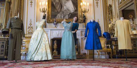 Textile, Dress, Formal wear, Floor, Flooring, Gown, Fashion, Teal, Aqua, Carpet,
