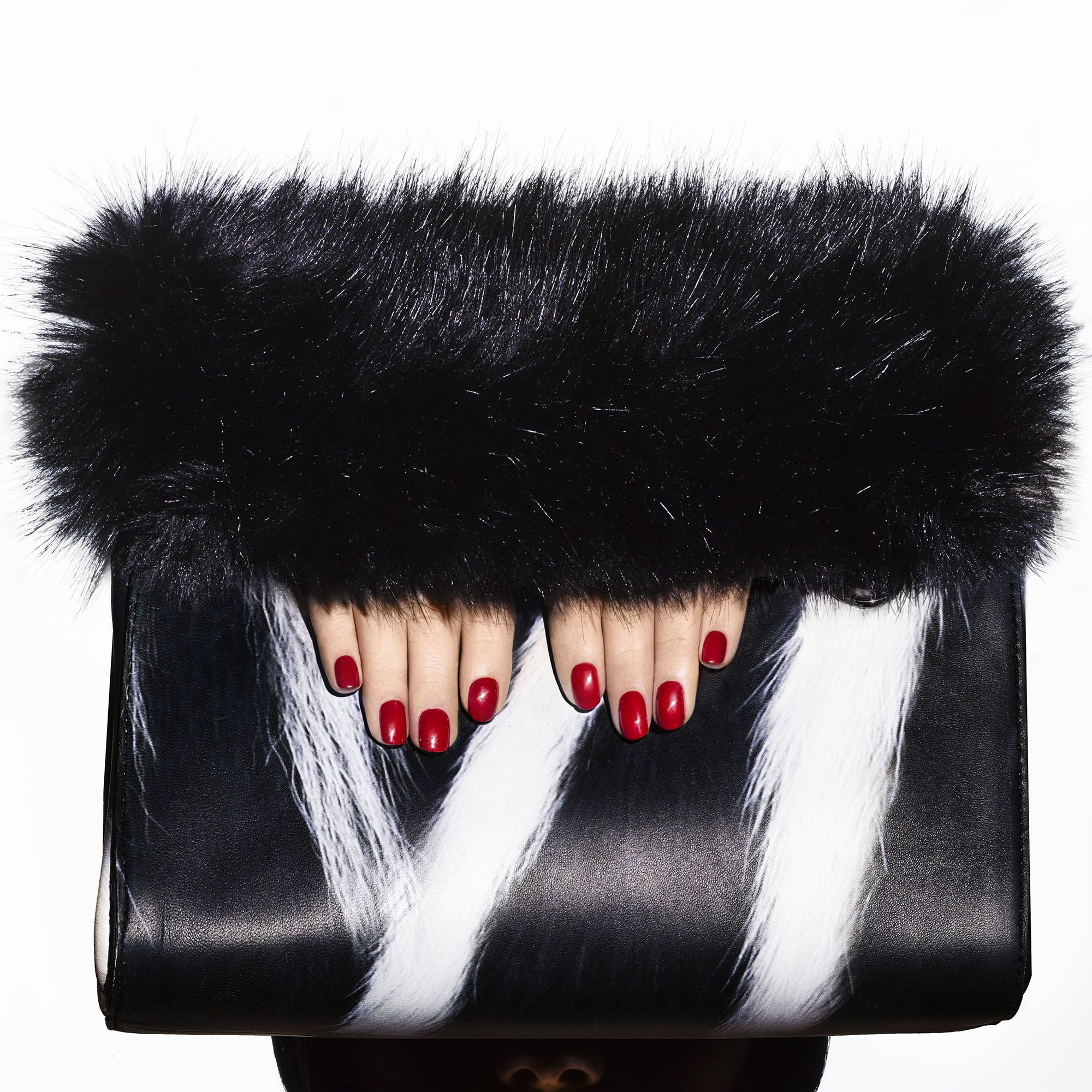 """<p><strong>BEAUTY BAZAAR:</strong><strong> </strong>For red-hot tips, try <a href=""""http://www.chanel.com/en_US/fragrance-beauty/makeup-colour-le-vernis-140404/sku/140409?WT.srch=1&WT.mc_id=FB_PLAMakeup424123889_en_US_&WT.mc_t=sea&gclid=CjwKEAjwqpK8BRD7ua-U0orrgkESJADlN3YB2dQnYei7co92NmdATTyy0HIm58vLjs4ncuZbibfuLxoCgcnw_wcB"""" target=""""_blank"""">Chanel Le Vernis Nail Colour</a> in Rouge Essentiel ($28).</p><p><strong>Calvin Klein Collection</strong> clutch, $1,995, 212-292-9000.</p>"""