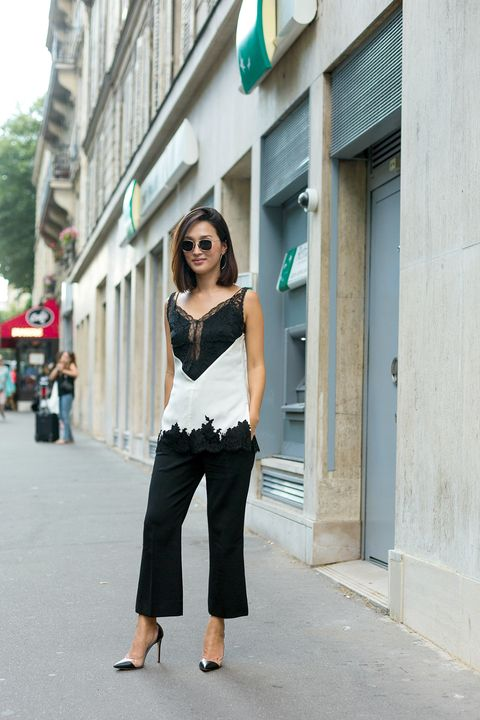 Clothing, Eyewear, Shoulder, Joint, Sunglasses, Outerwear, Standing, Style, Street fashion, Street,