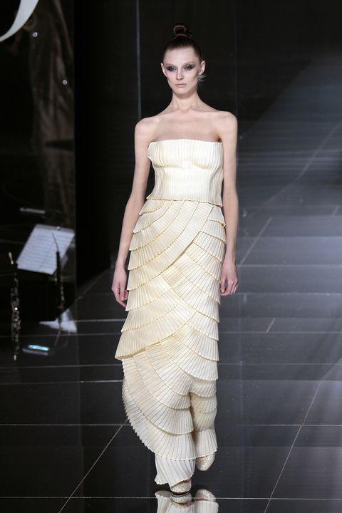 Shoulder, Fashion model, Fashion show, Style, Waist, Formal wear, Dress, Fashion, One-piece garment, Youth,