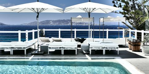 Property, Real estate, Outdoor furniture, Shade, Azure, Turquoise, Resort, Sunlounger, Design, Outdoor table,