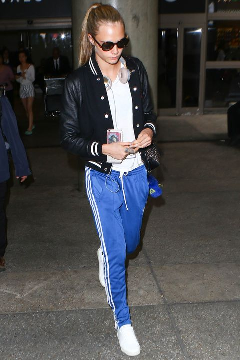 <p>Cara Delevingne can rock a sexy red carpet look with the best of them, but her default is sporty looks that leverage varsity jackets and track pants to very cool places. </p>