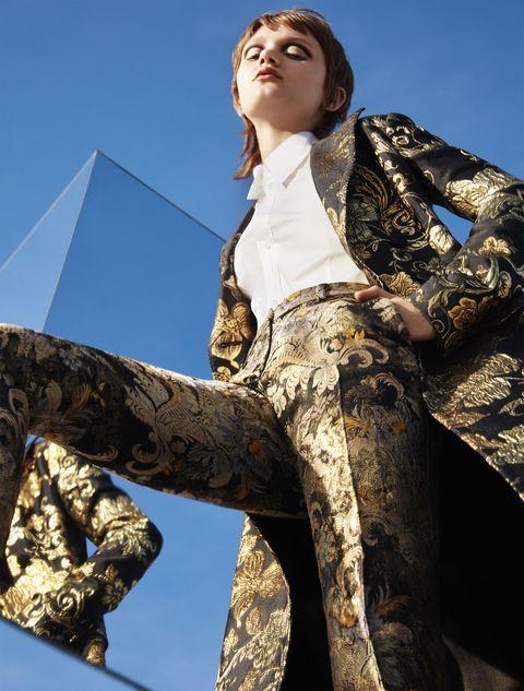 """<p><strong>Dolce & Gabbana</strong> coat, $4,595, 877-70-DGUSA&#x3B; <strong>Boss</strong> shirt, $180, <a href=""""http://www.hugoboss.com/us/home"""" target=""""_blank"""">hugoboss.com</a>&#x3B; <strong>Ralph Lauren Collection</strong> pants, $2,990, <a href=""""http://www.ralphlauren.com/home/index.jsp?direct"""" target=""""_blank"""">ralphlauren.com</a>. <br></p>"""