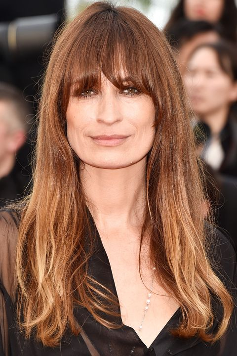 <p>The French beauty pairs well-done balayage with her signature undone texture.</p>