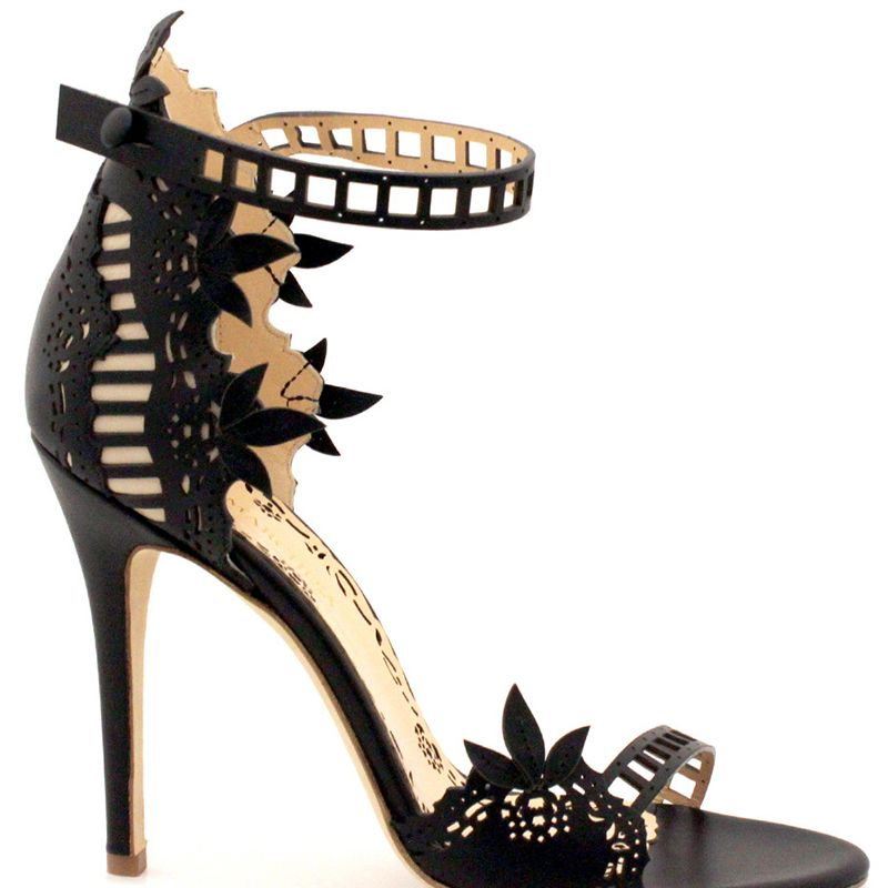 """<p>When visiting the UK, I'm always sure to pack a pair of heels that can be worn during the day as well as in the evening. You can't go wrong with a classic silhouette in black, like our Margaret sandals.</p><p><br></p><p><span></span><em>Marchesa Margaret sandals, $995,<strong> <a href=""""https://akh-group.myshopify.com/products/marchesa-shoes-margaret-black-sandal"""" target=""""_blank"""">myshopify.com</a></strong></em></p>"""