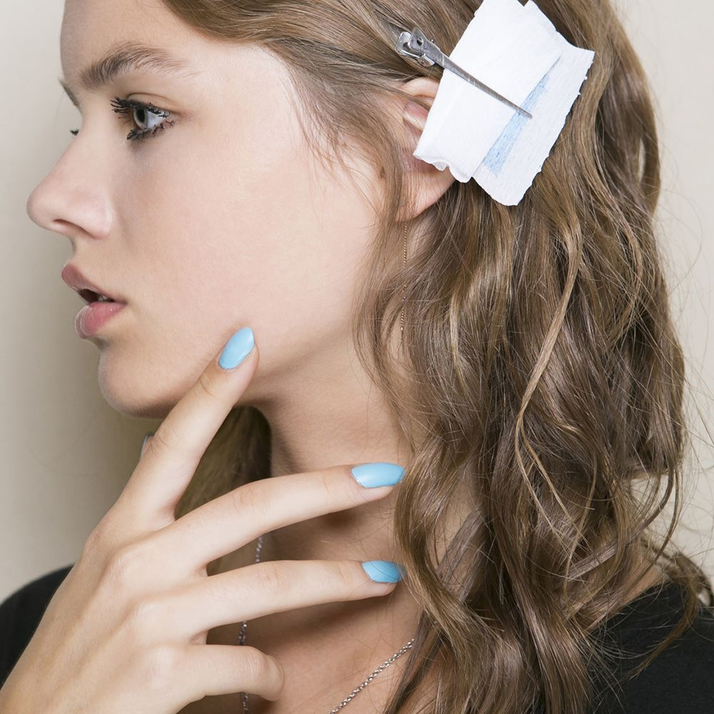 <p>At Au Jour Le Jour, models wore three shades—powder blue, canary yellow, and hot coral. On some looks, white polish was drizzled upwards from the cuticle. </p>