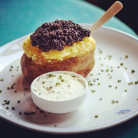 "<p>""It has almost as many selfies on Insta as Kim K, but the caviar topped buttery baked potato at <a href=""http://www.caviarkaspia.com/en/"" target=""_blank"">Caviar Kaspia</a> in Paris does not disappoint—it's pure decadence with the price tag to match.""</p>"