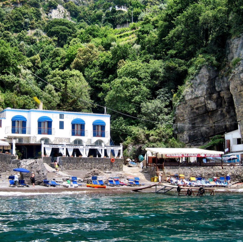 "<p>""Only accessible by boat, <a href=""http://www.daadolfo.com/"" target=""_blank"">Da Adolfo</a>–a seaside restaurant in Positano–makes the best seafood pasta I've ever had. Ordering a pitcher of their house-made sangria is also a must.""</p><p><i></i></p>"