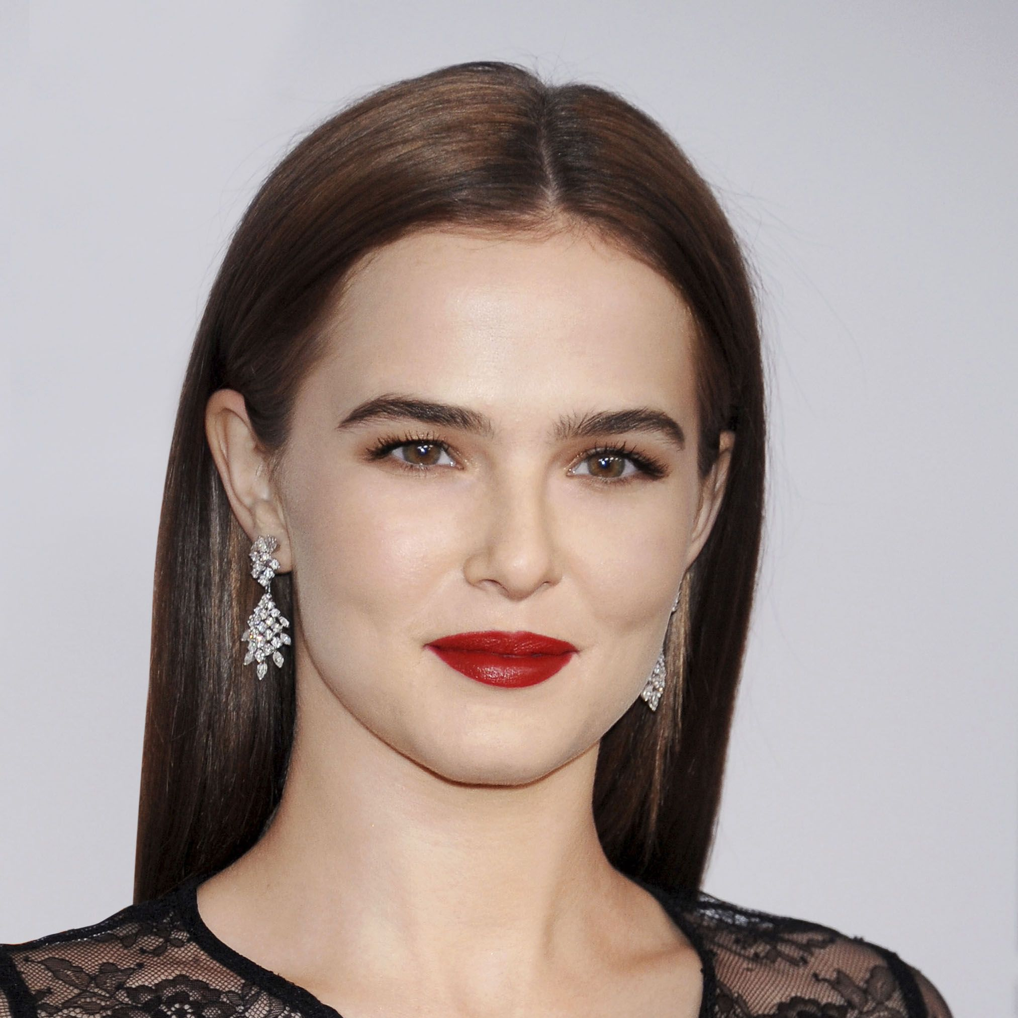 "<p>""I think the Hepburn lip is about looking amazing but approachable,"" says celebrity makeup artist <a href=""https://www.instagram.com/andremakeup/?hl=en"" target=""_blank"">Andre Sarmiento</a> who did Zoey's look here. ""It's not the the sharp matte statement lip of seasons past. It's perfect but soft&#x3B; rich but accessible. There's depth to the color and the texture is more satin. That's what makes it more modern for today.""</p>"