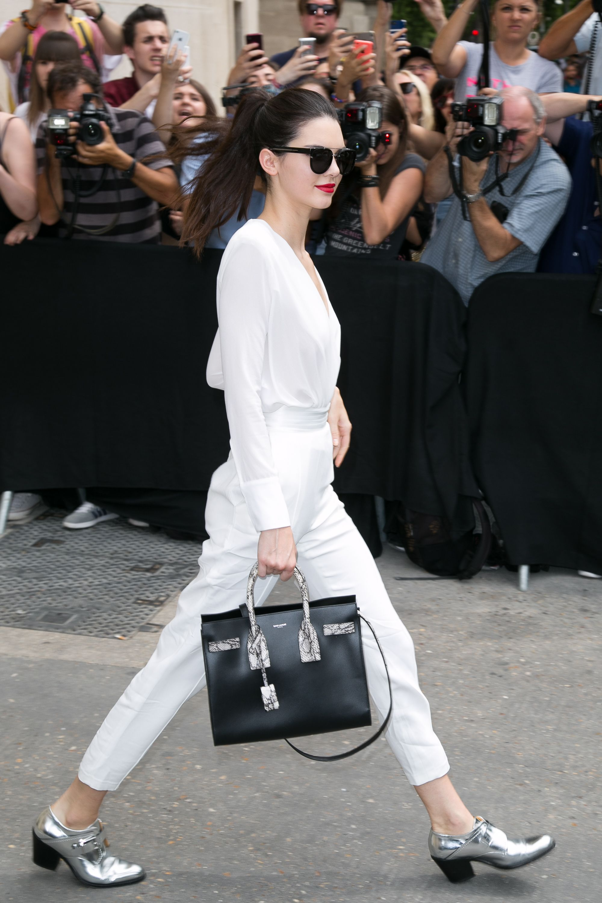 "<p>Kendall Jenner is beloved for her polished take on off-duty style, and you're just as likely to spot her in a sleek jumpsuit as jeans and a t-shirt. </p><p><strong data-redactor-tag=""strong"">Go-to look: </strong>Jeans, booties, and a comfortable t-shirt.</p><p><strong data-redactor-tag=""strong"">Her style in two words:</strong> "" Comfortably tailored.""</p><p><br></p>"