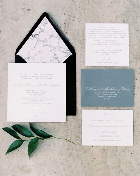 "<p>""We wanted something very simple and classic, and we both have really been into marble <em>everything</em> lately, so we decided to get a custom marbled liner for each invitation,"" explained Arielle. Keeping to their color palette of black and white, the couple worked with <a href=""http://www.paperzest.com/"" target=""_blank"" tabindex=""-1"">Paperzest</a> to create their stationery suite.</p>"