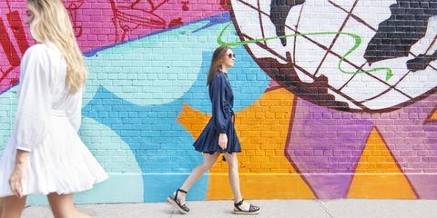 "<p>An inky-blue version takes you from day to dance-floor and beyond. </p><p><strong><em>Rhode Resort ""Ella"" dress in white and navy, $365, <a href=""https://shop.harpersbazaar.com/designers/r/rhode-resort/"" target=""_blank"">shopBAZAAR.com</a>. </em></strong><span class=""redactor-invisible-space""><br></span></p><p><em><em><i>Image: </i></em><i>Merchandising Director, Megan Reynolds (left), Senior Fashion Market Editor, Mallory Schlau (right)</i><span class=""redactor-invisible-space""></span><br></em></p>"
