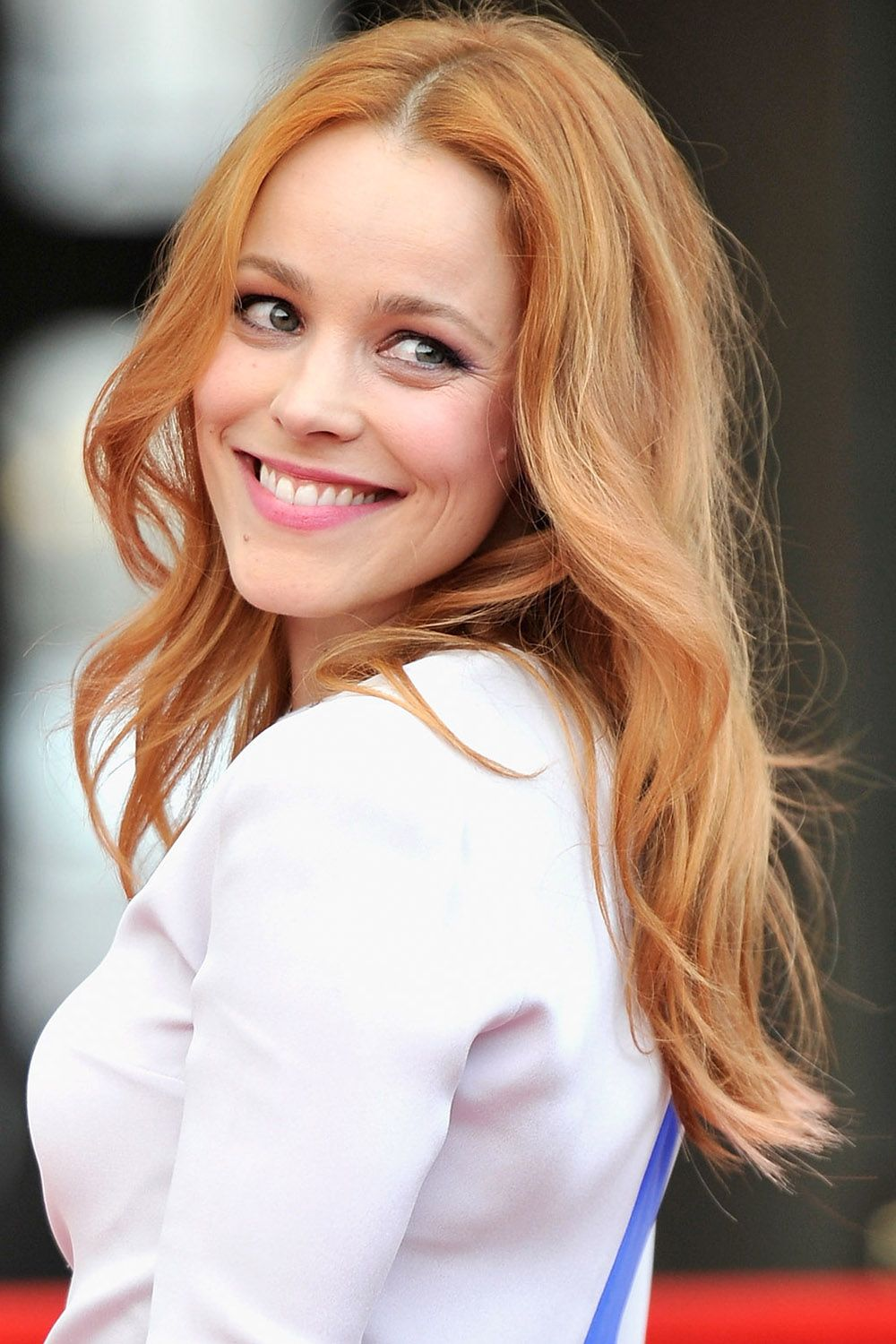 "<p>McAdams flaunts a glamorous combination of ginger highlights and flawless, undone waves.  <span class=""redactor-invisible-space""></span></p>"