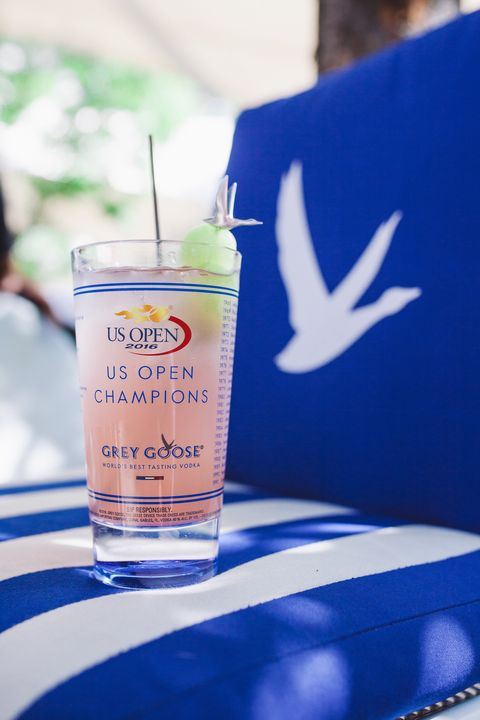"""<p>This year marks the 10th anniversary of the partnership between Grey Goose and the U.S. Open, and they're serving&nbsp;these delish drinks&nbsp;to thirsty tennis watchers in celebration. Don't forget the melon balls—they're 🔑.</p><p><strong data-redactor-tag=""""strong"""" data-verified=""""redactor"""">Ingredients:</strong></p><p>1.25 oz. Grey Goose Vodka</p><p>3 oz. Lemonade</p><p>.5 oz. Raspberry Liqueur</p><p>Garnish: Frozen Honeydew Melon Ball Skewer</p><p><strong data-redactor-tag=""""strong"""" data-verified=""""redactor"""">Directions:</strong></p><p>Chill a&nbsp;collins glass by placing in refrigerator/ freezer or by filling with ice water for 5 minutes. Remove from refrigerator/freezer&nbsp;and fill with ice. Measure and add vodka to the glass. Top with measured amount of fresh lemonade. Measure and add raspberry liqueur. Garnish with skewer of 1 or multiple frozen honeydew melon balls (note: place honeydew melon in freezer beforehand, then, to create melon balls, use melon baller).</p>"""