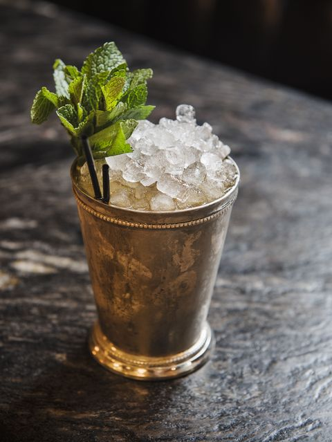 """<p>It's simple: You go to the Kentucky Derby for three things: betting, big hats, and mint juleps. Here's how to make the perfect one. </p><p><strong data-redactor-tag=""""strong"""" data-verified=""""redactor"""">Ingredients:</strong></p><p>2 cups sugar</p><p>2 cups water</p><p>Sprigs of fresh mint</p><p>Crushed ice</p><p>Old Forester Straight Bourbon Whisky (or similar)</p><p>Silver Julep Cups or Frosted Glasses</p><p><strong data-redactor-tag=""""strong"""" data-verified=""""redactor"""">Directions:</strong></p><p>Make a simple syrup by boiling sugar and water together for five minutes. Cool and place in a covered container with six or eight sprigs of fresh mint, then refrigerate overnight. Make one julep at a time by filling a julep cup with crushed ice, adding one tablespoon mint syrup and two ounces of&nbsp;Old ForesterKentucky Whisky. Stir rapidly with a spoon to frost the outside of the cup. Garnish with a sprig of fresh mint.<span class=""""redactor-invisible-space"""" data-verified=""""redactor"""" data-redactor-tag=""""span"""" data-redactor-class=""""redactor-invisible-space""""></span><br></p>"""