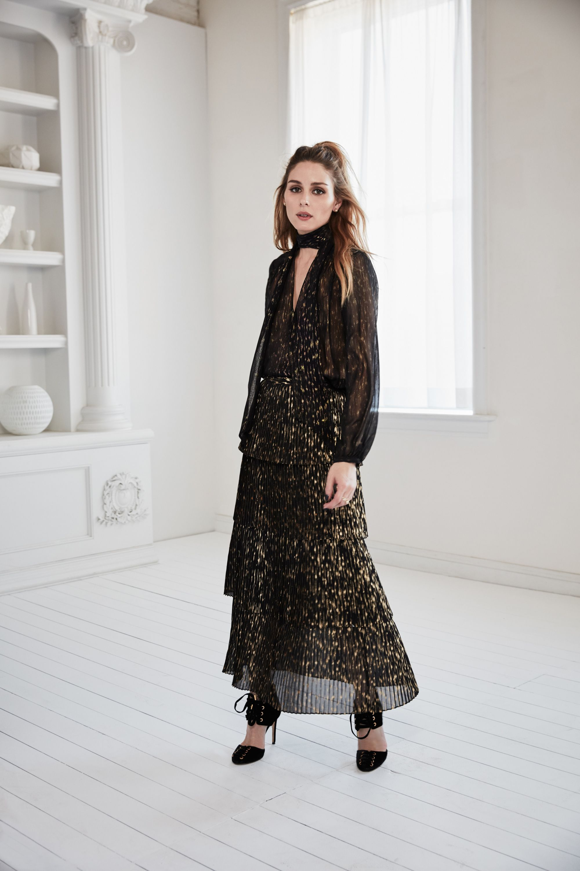 "<p>""Texture was also key. We loved pairing light, romantic elements like ruffles and lace with edgy leather or menswear-inspired tailored pieces. Materials like chiffon have a lot of movement and add an extra-pretty element to balance the menswear styles.<span class=""redactor-invisible-space"">"" —Olivia Palermo</span></p>"