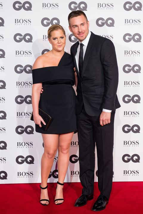 """<p>To accept her <em data-redactor-tag=""""em"""" data-verified=""""redactor"""">GQ</em> Woman of the Year Award, Amy Schumer brought <a href=""""http://www.marieclaire.com/celebrity/news/a17980/amy-schumer-boyfriend-instagram-pda/"""" target=""""_blank"""">her boyfriend of nine months</a> as a plus-one.&nbsp;</p>"""