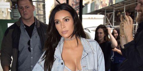 Kim Kardashian Wears A Sheer Bra & Over-the-Knee Boots for a Rainy Day