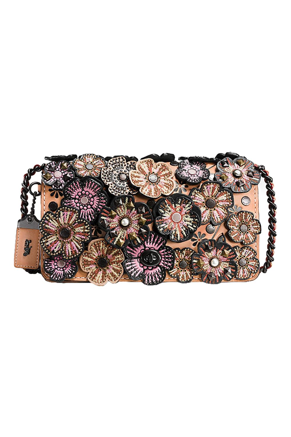 "<p>Covered in abundant embroidered floral applique—along with rivets, faux pearls, and pyramid studs—this handbag is fit for evening wear. One of its most practical features is an interior snap-closure purse, to keep your vitals securely in check. <em data-redactor-tag=""em"">$650, </em><em data-redactor-tag=""em""><a href=""http://www.coach.com/coach-designer-crossbody-embellished-tea-rose-applique-dinky-crossbody-in-glovetanned-leather/56258.html?dwvar_color=BPA55"" target=""_blank"">coach.com</a></em></p>"