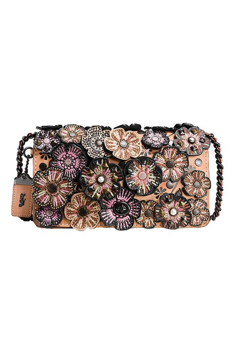 "<p>Covered in abundant embroidered floral applique—along with rivets, faux pearls, and pyramid studs—this&nbsp;handbag is fit&nbsp;for evening wear. One of its&nbsp;most practical features is an interior snap-closure purse, to keep your vitals securely in check. <em data-redactor-tag=""em"">$650, </em><em data-redactor-tag=""em""><a href=""http://www.coach.com/coach-designer-crossbody-embellished-tea-rose-applique-dinky-crossbody-in-glovetanned-leather/56258.html?dwvar_color=BPA55"" target=""_blank"">coach.com</a></em></p>"
