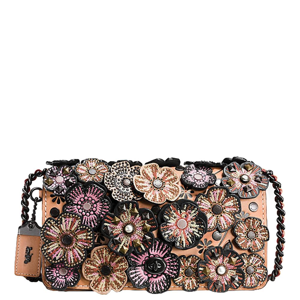"<p>Covered in abundant embroidered floral applique—along with rivets, faux pearls, and pyramid studs—this&nbsp&#x3B;handbag is fit&nbsp&#x3B;for evening wear. One of its&nbsp&#x3B;most practical features is an interior snap-closure purse, to keep your vitals securely in check. <em data-redactor-tag=""em"">$650, </em><em data-redactor-tag=""em""><a href=""http://www.coach.com/coach-designer-crossbody-embellished-tea-rose-applique-dinky-crossbody-in-glovetanned-leather/56258.html?dwvar_color=BPA55"" target=""_blank"">coach.com</a></em></p>"