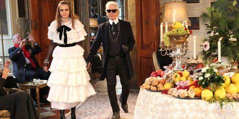 Trousers, Coat, Outerwear, Suit, Dress, Fruit, Produce, Natural foods, Bouquet, Sunglasses,