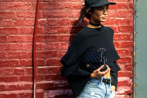 Brick, Sleeve, Shoulder, Hat, Denim, Red, Wall, Brickwork, Street fashion, Waist,