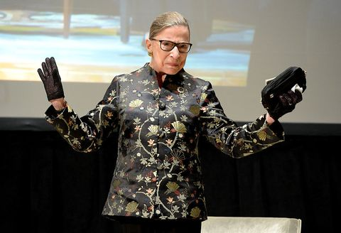 Eyewear, Glasses, Sleeve, Human body, Hand, Gesture, Revolver, Orator, Camera, Public speaking,