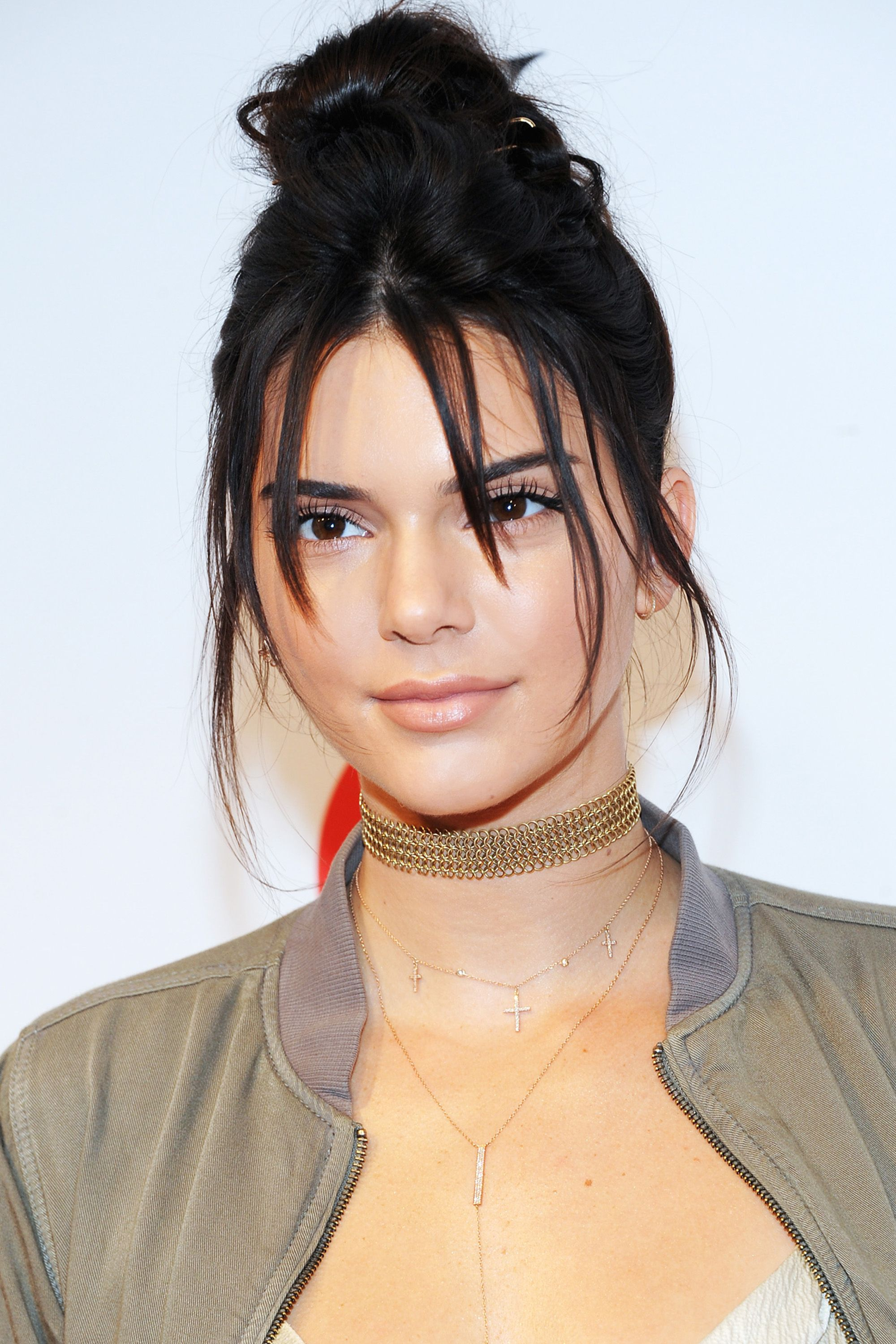 "<p><strong data-redactor-tag=""strong"">Who:</strong> Kendall Jenner</p><p><strong data-redactor-tag=""strong"">What: </strong>No Fuss Top Knot</p><p><strong data-redactor-tag=""strong"">Why: </strong>We've all had haircuts that look better down than up. At the Target + IMG NYFW kick-off event last night in New York City, Jenner didn't let long layers stop her. Which is informative for the rest of us: Even if they're in your eyes, or along your cheeks, piecey bits can lend low-key edge to simple styles.</p><p><strong data-redactor-tag=""strong"">Editor's Pick: </strong><strong data-redactor-tag=""strong"">Down & Out</strong> Dirty Spray, $29, <a href=""http://www.sephora.com/down-out-dirty-spray-P410496?skuId=1839570&icid2=products%20grid:p410496"">sephora.com</a>. </p>"