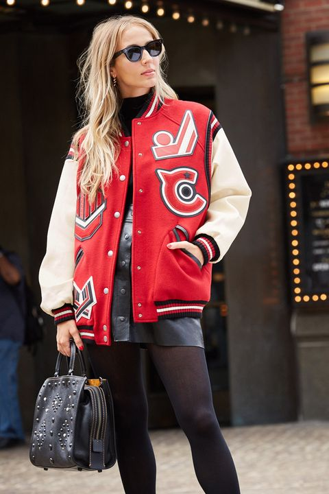 "<p>A varsity jacket distills timeless American style into a chic piece of outwear that also keeps you cozy. ""Everyone should have a fun varsity jacket at some point in their lives,"" says Viera-Newton. ""Whether it was their dad's or boyfriend's or from a team they were on... It's the kind of thing you create memories in and have a strong attachment to."" Viera-Newton suggests throwing it over a skirt to add edge to your evening look, or layer it with a big sweater and jeans for daytime ease. </p><p><br> </p><p><em data-redactor-tag=""em"">Coach 1941 Oversized Varsity Jacket, $1195, <a rel=""noskim"" href=""http://www.coach.com/coach-designer-vest-oversized-varsity-jacket/56368.html?CID=D_B_HBZ_11815"" target=""_blank"">coach.com</a>; Coach 1941 Western Rivets Rogue Bag, $995, <a rel=""noskim"" href=""http://www.coach.com/coach-designer-purses-western-rivets-rogue-bag-in-pebble-leather/56617.html?dwvar_color=BPBLK&amp;CID=D_B_HBZ_11816"" target=""_blank"">coach.com</a></em></p>"