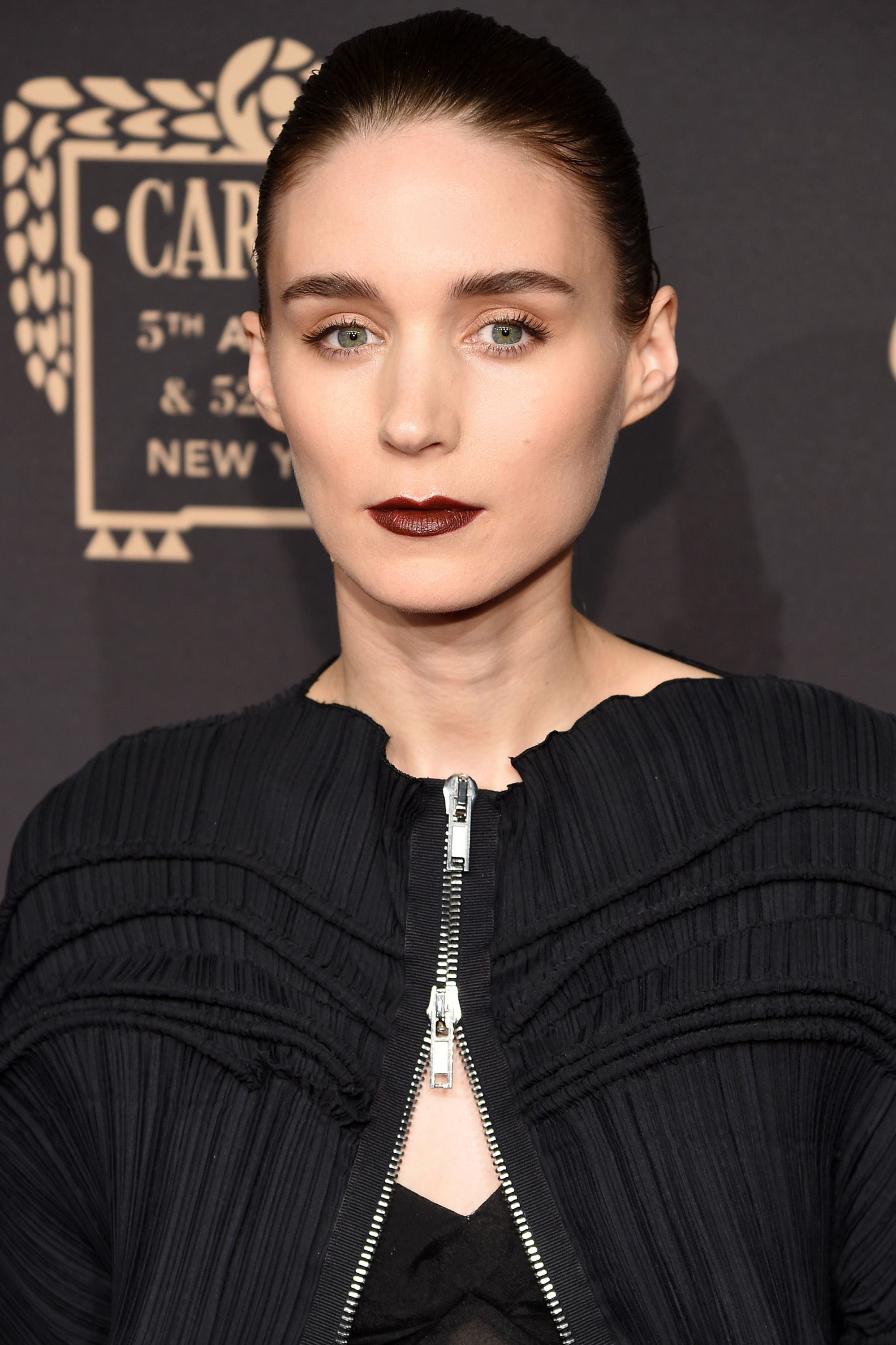 "<p><strong data-redactor-tag=""strong"">Who:</strong> Rooney Mara</p><p><strong data-redactor-tag=""strong"">What: </strong>That Dreamy '90s Lip</p><p><strong data-redactor-tag=""strong"">Why: </strong>For a Cartier event last night, makeup artist Kate Lee gave the actress an, ""alabaster complexion, apricot eyes and a 90s-inspired lip."" Notice the low-key balance between a sheer gilded wash on the lids and the earthy, purpley brick on the lips. </p><p><strong data-redactor-tag=""strong"">Editor's Pick: </strong><strong data-redactor-tag=""strong"">Urban Decay </strong><span class=""redactor-invisible-space"" data-verified=""redactor"" data-redactor-tag=""span"" data-redactor-class=""redactor-invisible-space"">Eyeshadow in Freelove,</span> $19, <a href=""http://www.sephora.com/eyeshadow-P309813?skuId=1402908&icid2=products%20grid%3Ap309813"">sephora.com</a>.</p>"