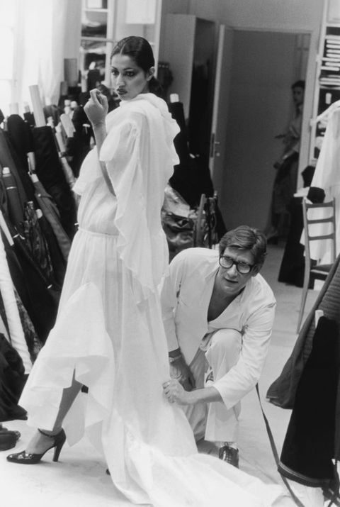 "<p>Yves Saint Laurent in his studio fitting a toile from the Autumn/Winter 1977 haute couture collection on the model Kirat<span id=""selection-marker-1"" class=""redactor-selection-marker"" data-verified=""redactor""></span></p>"