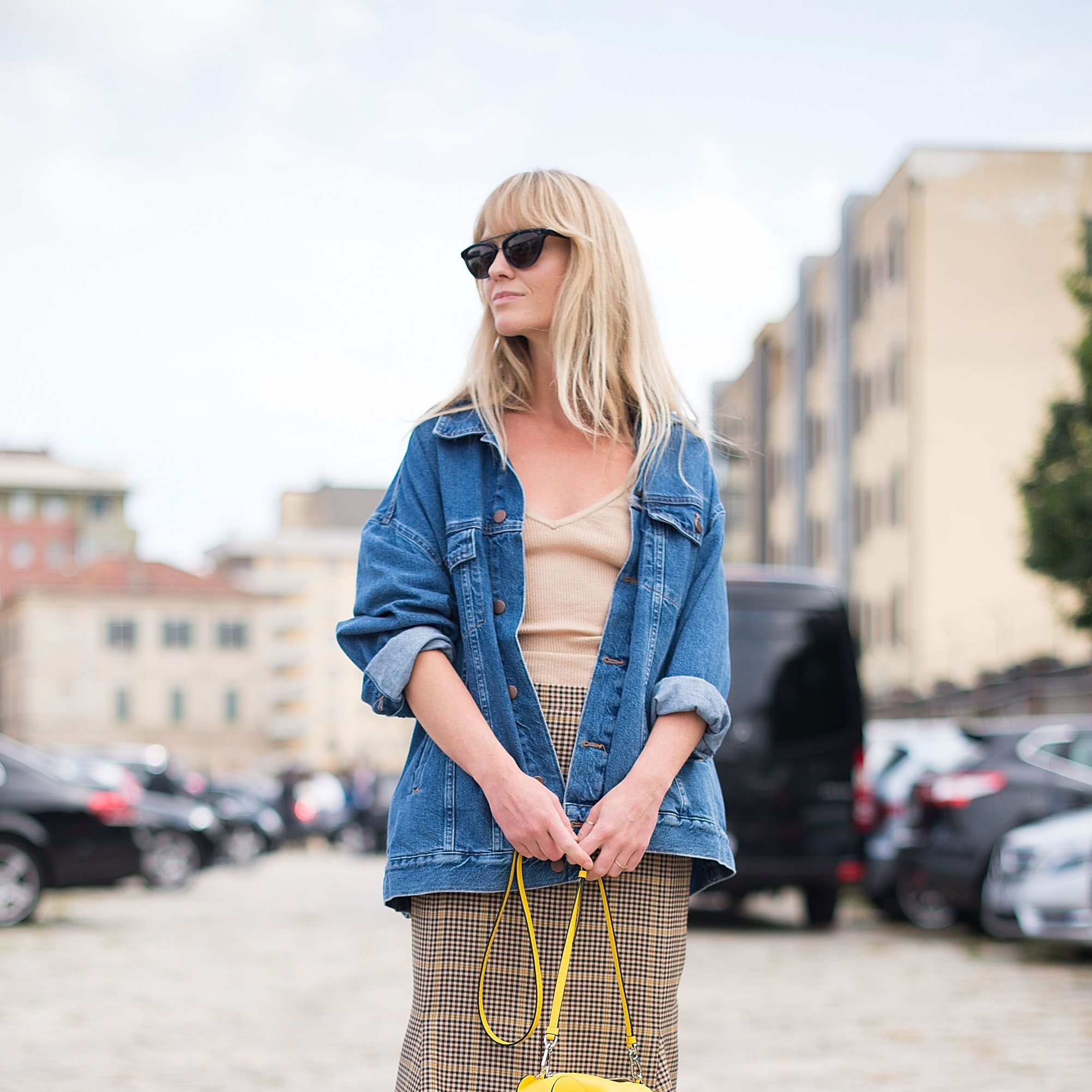 <p>Breathe new life into a classic plaid skirt by adding an oversized denim jacket and whimsical accessory.&nbsp&#x3B;</p>
