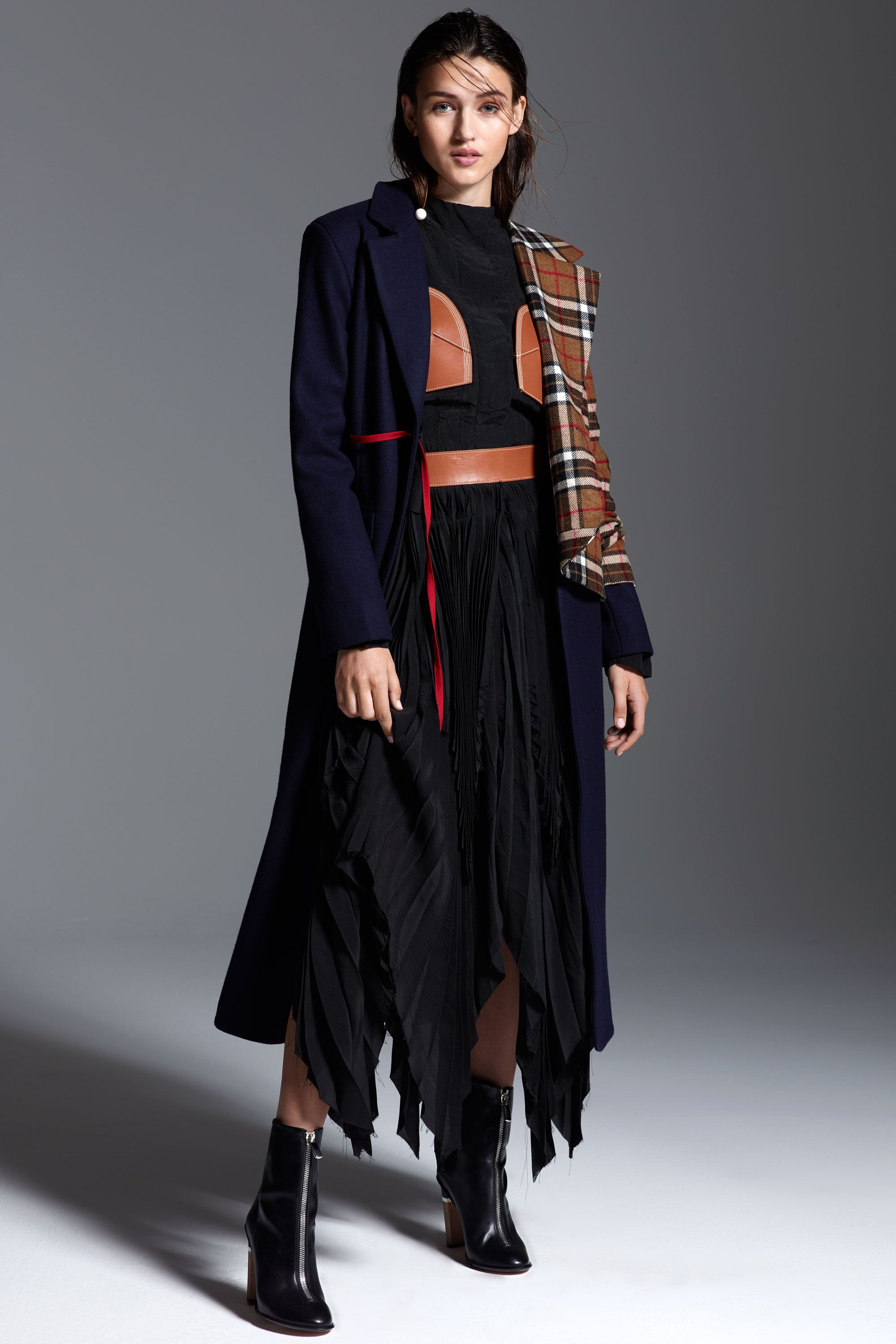 "<p>Deconstruction and reconstruction are major themes in fashion for fall. Nail the look with a patchwork coat—<span class=""redactor-invisible-space"" data-verified=""redactor"" data-redactor-tag=""span"" data-redactor-class=""redactor-invisible-space""></span>complete with an craftsy-chic outfit underneath. <span class=""redactor-invisible-space"" data-verified=""redactor"" data-redactor-tag=""span"" data-redactor-class=""redactor-invisible-space""></span></p><p><em data-redactor-tag=""em"" data-verified=""redactor""><strong data-redactor-tag=""strong"" data-verified=""redactor"">Jacquemus</strong> 'Le Manteau Vest' Long Wool Coat, $1,190, <a href=""http://shop.nordstrom.com/s/jacquemus-le-manteau-vest-long-wool-coat/4336665?&cm_mmc=Mindshare_Nordstrom-_-WAP_October-_-Hearst-_-proactive"" target=""_blank"">nordstrom.com</a>; <strong data-redactor-tag=""strong"" data-verified=""redactor"">Loewe</strong> Top and Pleated Midi Skirt, for similar styles visit <a href=""http://shop.nordstrom.com/c/loewe?origin=productBrandLink&page=2&top=66"" target=""_blank"">nordstrom.com</a>; <strong data-redactor-tag=""strong"" data-verified=""redactor"">BOSS</strong> Zip Booties, $1,095, <a href=""http://www.hugoboss.com/us/%27zip-bootie%27-italian-calfskin-zip-ankle-boot/hbna50326443.html?cgid=12001&dwvar_hbna50326443_color=001_Black#start=1"" target=""_blank"">hugoboss.com</a>; <strong data-redactor-tag=""strong"" data-verified=""redactor"">Stella McCartney</strong> Long Ball Detail Earring, $630, </em><a href=""https://www.farfetch.com/shopping/women/Stella-McCartney-long-ball-detail-earrings-item-11664901.aspx?utm_source=gcdL/ATRVoE&utm_medium=affiliate&utm_campaign=Linkshareus&utm_content=10&utm_term=USNetwork"" target=""_blank""><em data-redactor-tag=""em"" data-verified=""redactor"">farfetch.com</em></a></p>"