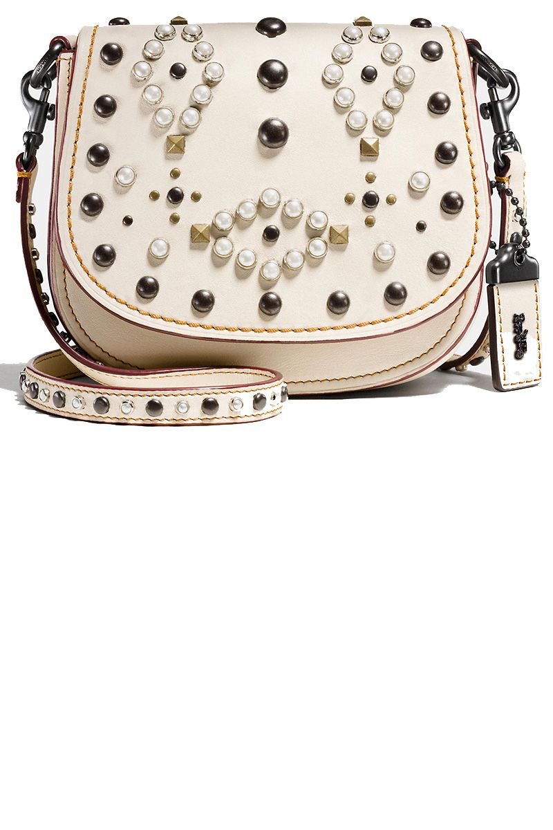 "<p><strong data-redactor-tag=""strong"" data-verified=""redactor"">Coach</strong> bag, $450, <a href=""http://www.coach.com/coach-designer-crossbody-western-rivets-saddle-bag-17-in-glovetanned-leather/56564.html?search=true&amp&#x3B;dwvar_color=BPCHK"" target=""_blank"">coach.com</a>.</p>"