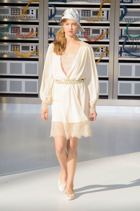 Sleeve, Shoulder, Dress, Joint, Human leg, Style, Fashion show, Shelf, One-piece garment, Street fashion,