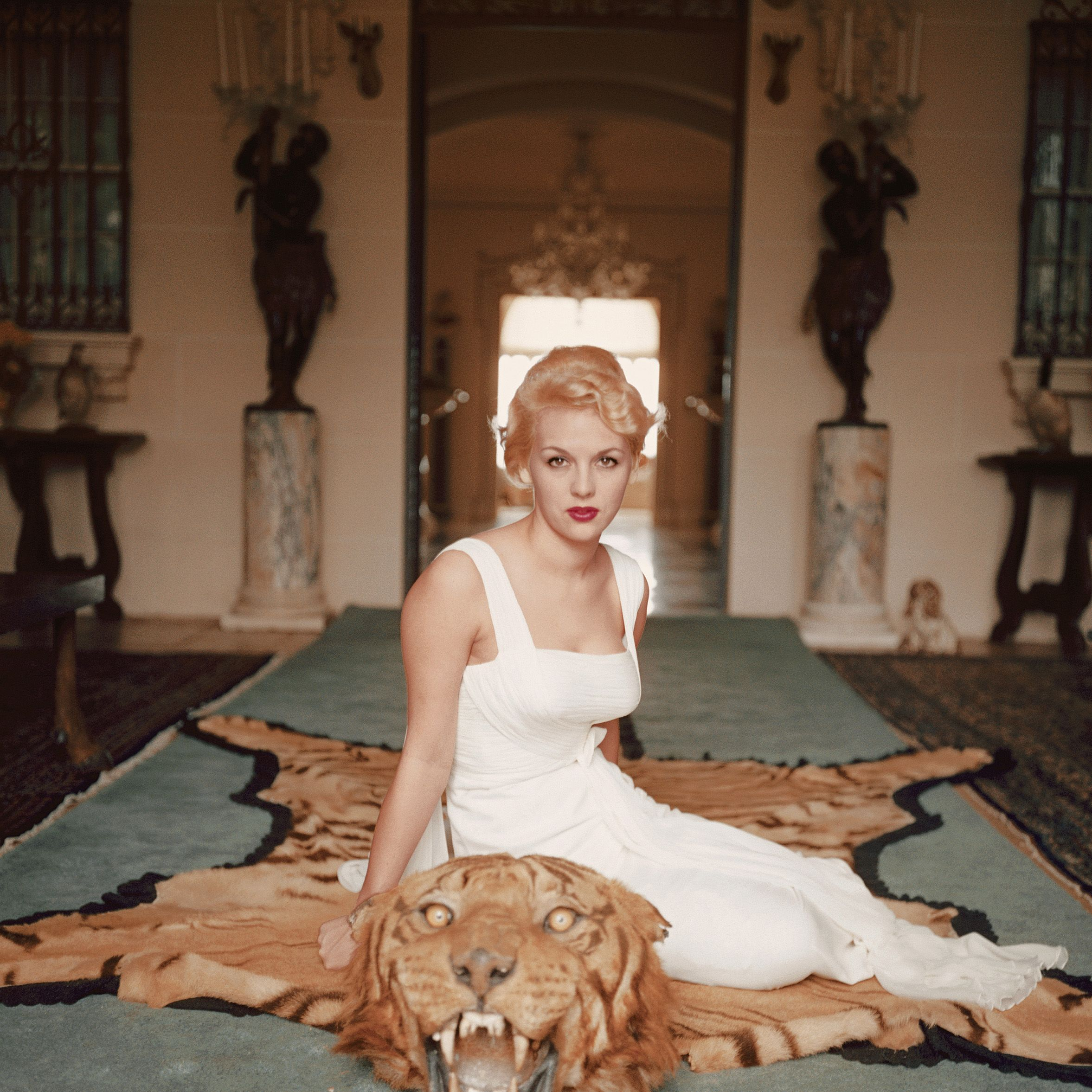 """<p>Lady Daphne Cameron sits on a tiger pelt in the trophy room of Laddie Sanford's Palm Beach house.<span class=""""redactor-invisible-space"""" data-verified=""""redactor"""" data-redactor-tag=""""span"""" data-redactor-class=""""redactor-invisible-space""""></span></p>"""