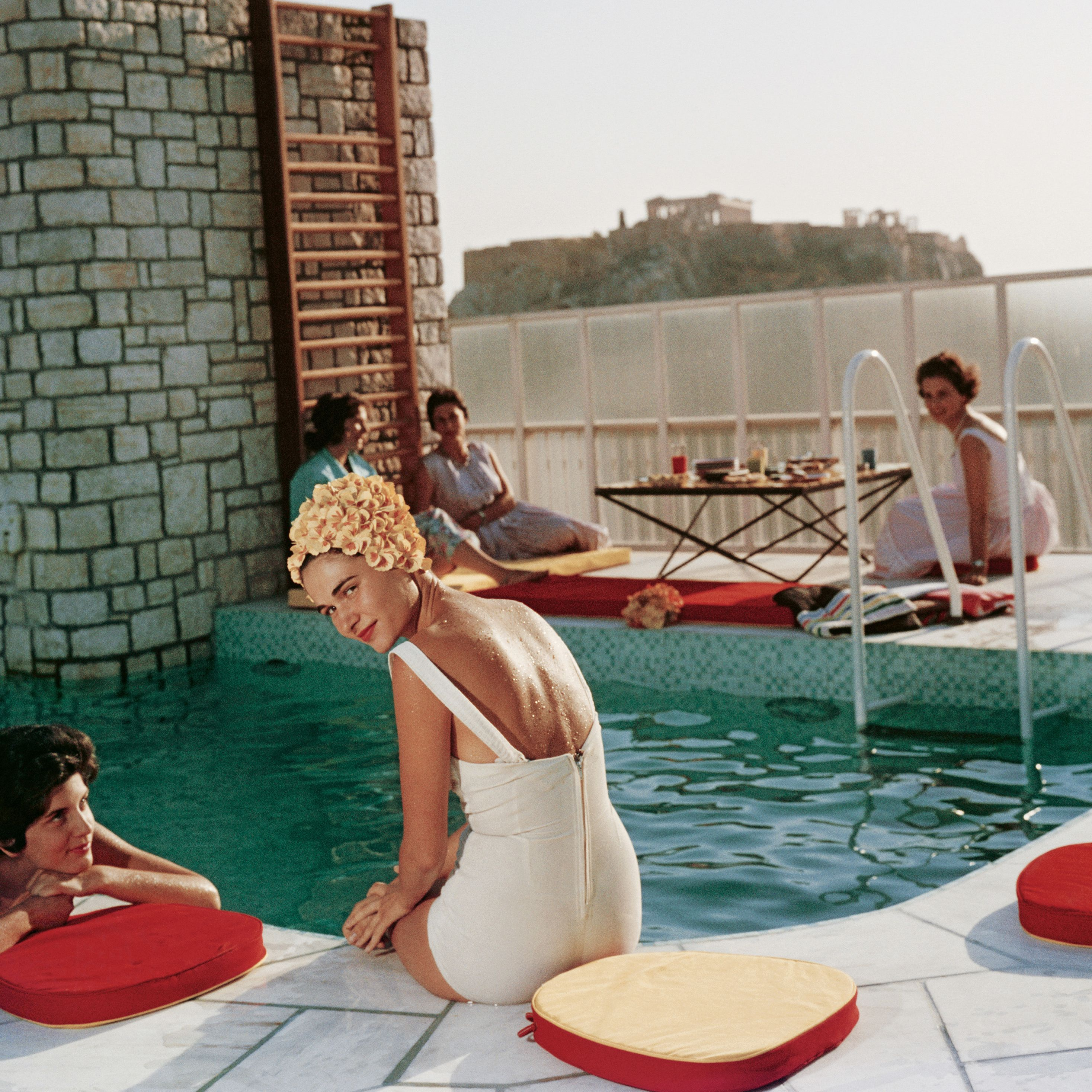 """<p>Guests relax around the Canellopoulos penthouse pool, Athens.<span class=""""redactor-invisible-space"""" data-verified=""""redactor"""" data-redactor-tag=""""span"""" data-redactor-class=""""redactor-invisible-space""""></span></p>"""